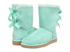 Teal uggs with two bows on the back.
