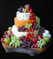 "Cheese wheel and grape ""cake"" would be perfect for a wine tasting party!"