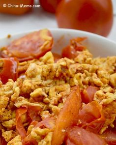 A simple Chinese home cooking recipe, Egg Fried Tomatoes. The tender and fluffy eggs are mixed with the succulent tomatoes, plus the flavour of garlic and spring onion. Simple, healthy and tasty.