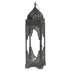 Moroccan-style metal candle lantern with intricate openwork detail and glass panels.