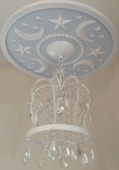 Nursery Ceiling Medallions by Marie Ricci. Moon & Stars shown in pale powder blue. Crown Chandelier and medallion $270 www.mariericci.com