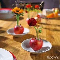 Hersbtliche Tischdekorationen mit Äpfeln