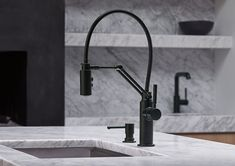 Minimalist and functional. Inspired by contemporary Scandinavian furniture, the Solna kitchen collection by  Brizo has crisp lines and a  simple form. This model in particular is designed to bring greater versatility to common kitchen tasks. The articulating arm offers a larger range of movement than a traditional pull-down faucet—letting you perfectly position the faucet for any task at hand.
