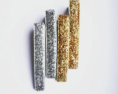 Stunning Gold + Silver Hair Clips. Super stylish no shed glitter ribbon. Our clips are lead and nIckel free. They are durable and provide a strong grip. Glitter Ribbon, Silver Hair, Hair Clips, Hair Accessories, Strong, Etsy Shop, Stylish, Gold, Free