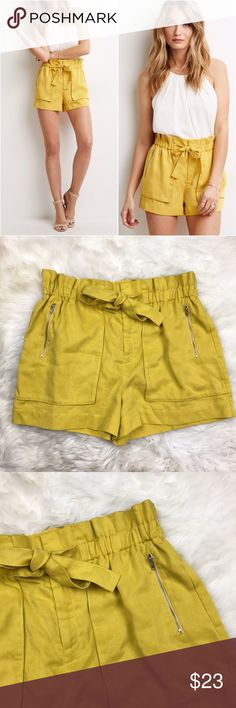 """SOLD❌Forever 21 Yellow High Waist Paper Bag Shorts In excellent used condition. Two front silver zipper pockets, no back pockets, center front zipper with hook clasp closure. Drawstring tied waist, elastic waistband. Waist measures 16"""" laying flat can stretch to 21"""", front rise is 13"""", inseam is 3"""", length is 15"""". ❌NO TRADES OR PAYPAL❌ Forever 21 Shorts"""