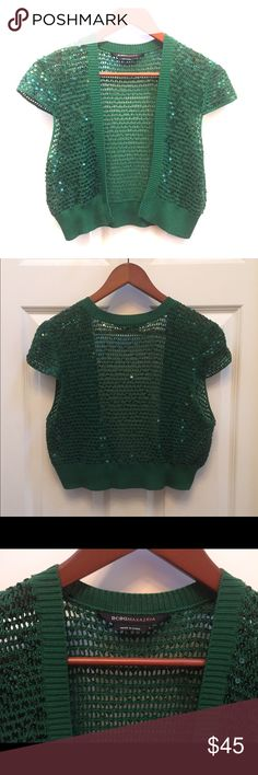 BCBG MAXAZRIA Green Sequin Crop Knit Jacket BCBG MAXAZRIA Emerald Green Sequin Knit Crop Jacket/Shrug   Goes great with jeans or a fancy dress…and perfect for summer nights out!   NEW AND NEVER WORN   SIZE:  L   COLOR:  EMERALD GREEN  Also, I'm always open to any offers...I promise I won't get offended :) Thanks! BCBGMaxAzria Sweaters Shrugs & Ponchos