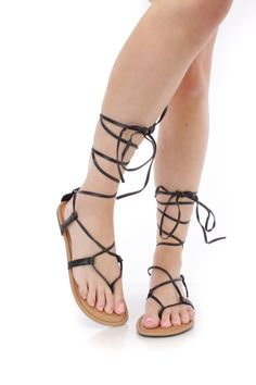 These sexy and stylish sandals are a must have this season! The features include a faux leather upper with a wrap around string tie design, thong post, smooth lining, and cushioned footbed.