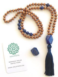 This 108 bead Mala necklace is created with Sandalwood and Lapis Lazuli beads with a Lapis Lazuli nugget guru bead. This spiritual necklace is strung on a blue thread with a blue tassel. The approximate length including the tassel is This mal Horseshoe Necklace, 14k Gold Necklace, Diy Necklace, Initial Necklace, Necklace Ideas, Jewelry Ideas, Jewelry Accessories, Necklace Tutorial, Craft Jewelry