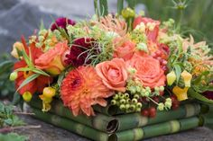 orange-dahlias-and-summer-flowers-detail-francoise-weeks. Love the use of rolled foliage at the base.