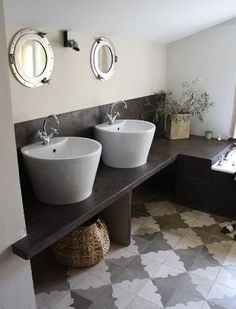 Beautiful mosaic floor and portal windows.  What an interesting and stylish bathroom! #decor #mosaic
