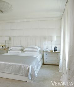 Laquered ceilings and satin-covered panels add texture to this bedroom by Victoria Hagan.
