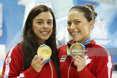July 13 - Diving - Women's Synchronised 10m Platform. Canada's Meaghan Benfeito and Roseline Filion show off their gold medals that they won in the women's 10 metre synchronized platform diving final at the Pan Am Games at CIBC Aquatic Centre/Field House in Toronto. July 13, 2015.