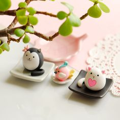 little clay cats with a bird by joojoo... love the idea of putting litle clay friends in a plant