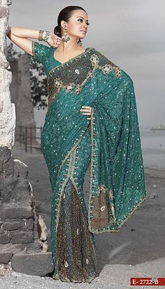 """The sari is a traditional Indian garment worn on the outside of an outfit. The fabric is usually lightweight that can be embellished with beading. It is draped around the waist and up over the shoulder, and it sometimes is worn over the head for covering. """"Enigma Wedding Sarees."""" Facebook. N.p., 9 Dec. 2010. Web. 05 Mar. 2013."""