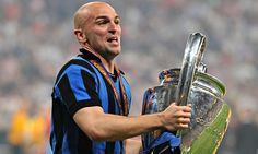 Esteban Cambiasso with the Champions League trophy won with Inter Milan in 2010.