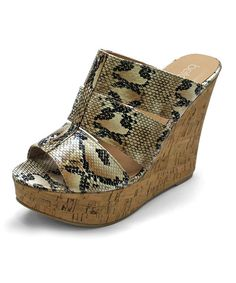 When it comes to contemporary cool, this platform wedge will always be several steps ahead! Its ample-sized heel boosts height and confidence whether worn with a dress or jeans.