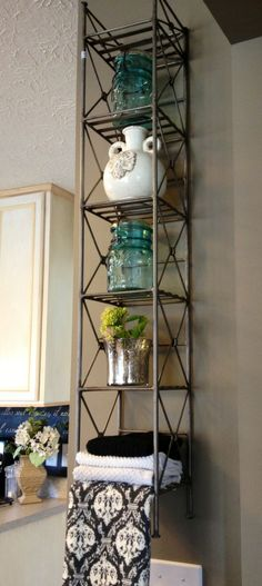 A simple upcycle using a CD tower as a kitchen shelf