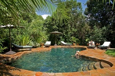 Honeymooners relaxing in Sanctuary Olonana's pool, Kenya