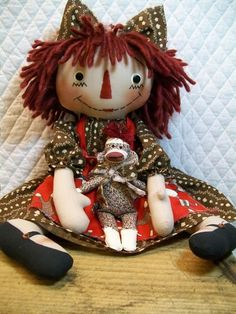 This is a raggedy ann type doll I have sewn from coffee stained muslin. She is about 19 inches tall with a lightly weighted bottom. I have