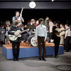 """The Rolling Stones perform on the British TV show """"Ready Steady Go!,"""" at Kingsway Studios. Photograph by David Redfern/Redferns/Getty."""