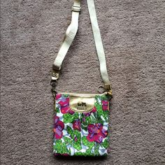 Rare Coach crossbody spring purple floral poppy Cute crossbody.  Only worn a few times, great condition.  Rare hard to find pattern. Coach Bags Crossbody Bags