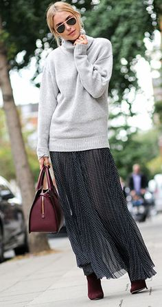Pernille Teisbaek is wearing a grey knit sweater and skirt from Joseph, suede boots from Jimmy Choo, bag from Matthew Williamson and sunglasses from RayBan. Photography by Alix De Beer