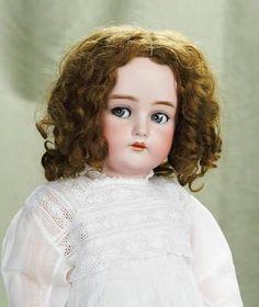 Pretty German bisque child with flirty eyes