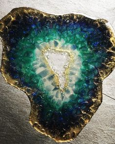 "NEW GEODE RESIN TABLE :) I get so many questions about ""is it wood?"" Who da fuck asks if this is wood? Oh yeah I see green n blue trees everywhere when I ain't acid tripping! 🤣 , ""is it on Glas?"" or ""what surface is it?"" —— it's ONLY RESIN WITH… Epoxy Resin Art, Eco Resin, Pebeo Vitrail, Resin Table Top, Resin Furniture, Furniture Dolly, Resin Artwork, Resin Paintings, Interior Design Images"