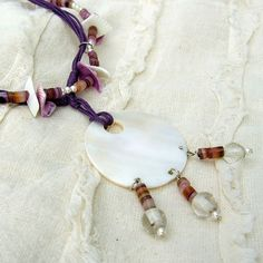 Items similar to Purple tones, shells and cord, round pearl pendant, crystal glass beads Necklace on Etsy Handmade Jewellery, Unique Jewelry, Handmade Gifts, Pearl Pendant, Cord, Shells, Beaded Necklace, Beige, Pearls