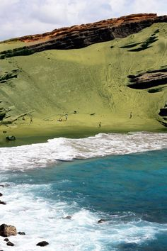 Papakōlea Beach (also known as Green Sand Beach or Mahana Beach) is a green sand beach located near South Point, in the Kaʻū district of the island of Hawaiʻi. One of only two green sand beaches in the World, the other being in Galapagos Islands. It gets its distinctive coloring from the mineral olivine, found in the enclosing cinder cone.