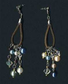 Earring findings, faux pearls, seed beads  and crystal beads are recycled from thrift store jewelry.