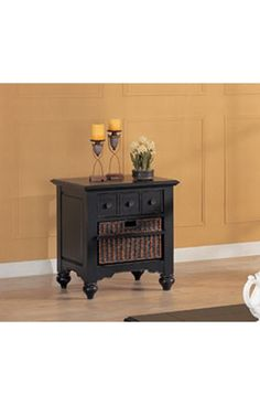 Rubbed black end table with center display shelf and 1 handwoven