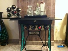 Old Singer Sewing Machine refurbished and hand painted for a mini bar