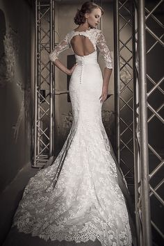 Gorgeous lace wedding gown with satin base. Mermaid style is very modern and elegant. Makes every bride look absolutely stunning. Long sleeves