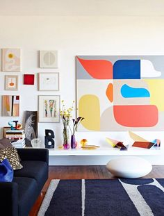 Above: Big pieces don't have to be the only art in the room. This synthesis of an oversized canvas and a (sort of) gallery wall works surprisingly well.