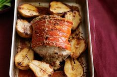 Roast pork with macadamia and sage stuffing with roasted pears, I put halved apples in as well ... just delicious