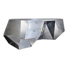 The Cubist Desk    Contemporary  This handmade desk is cladded completely with polished stainless steel.