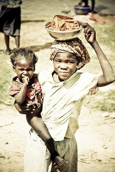 siblings stand under the hot sun in Chad, Africa