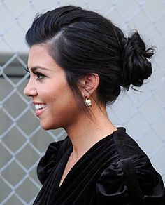 Messy bun hairstyle -- Kourtney Kardashian