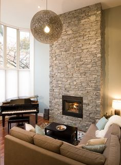 I like the small sectional by the fireplace.
