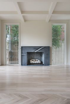 Cozy Corner Fireplace Design Ideas in the Living Room Fireplace Mantle, Fireplace Surrounds, Fireplace Design, Fireplace Ideas, Fireplace Windows, Simple Fireplace, Black Fireplace Surround, Minimalist Fireplace, Wooden Mantle