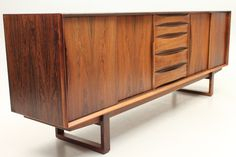 Low credenza in rosewood with drawers and 4 sliding doors. Designed in 1961 by Arne Vodder and manufactured by Sibast Furniture, Denmark. www.reModern.dk