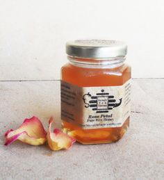Raw Colorado honey infused with organic rose petals- without any additional ingredients, this honey can be stirred into a cup of hot water and served as a tea.