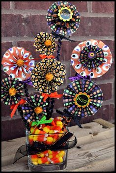 Tweak for spring or other seasons. If using for spring, inter-mingle pinwheels. For other holidays or seasons, use other appropriate items. The Autocrat: Halloween Paper Bouquet