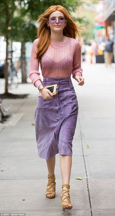Pastels: The Blended star was quite a vision in a sheer pink blouse, teamed with a lavender bra and velvet midi skirt adorned with a row of black buttons