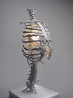 Jacob Allen Schroeder- Peter Crayola Model Magic, metal rod, armature wire, rice paper, paper mache, spray paint and accent light