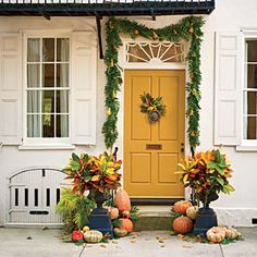 Love the garland and color door----Pumpkin Ideas for Your Front Door   Lowcountry Charm   SouthernLiving.com