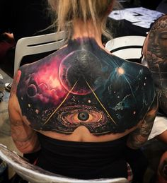 """Hidden in the vast galaxy is an """"all seeing eye"""" which adds more mystery to your tattoo. However the symbol is generally for symbolism of spiritual awakening and power."""