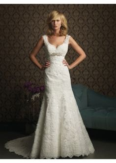Allure Bridals 8770. This gorgeous style is created from a rich lace appliqué on soft net. The sculpted neckline features scalloped straps and a v-shaped back. The empire waist is accented with a Swarovski crystal brooch.  http://www.mestads.com/dresses/shopping/allure-bridals-8770.html