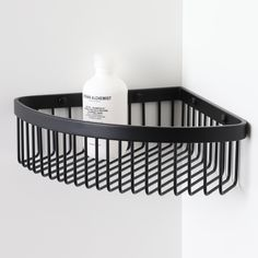 High-quality luxury corner bar basket, ideal for keeping your bottles neat and tidy!  Finished in Matte Black.